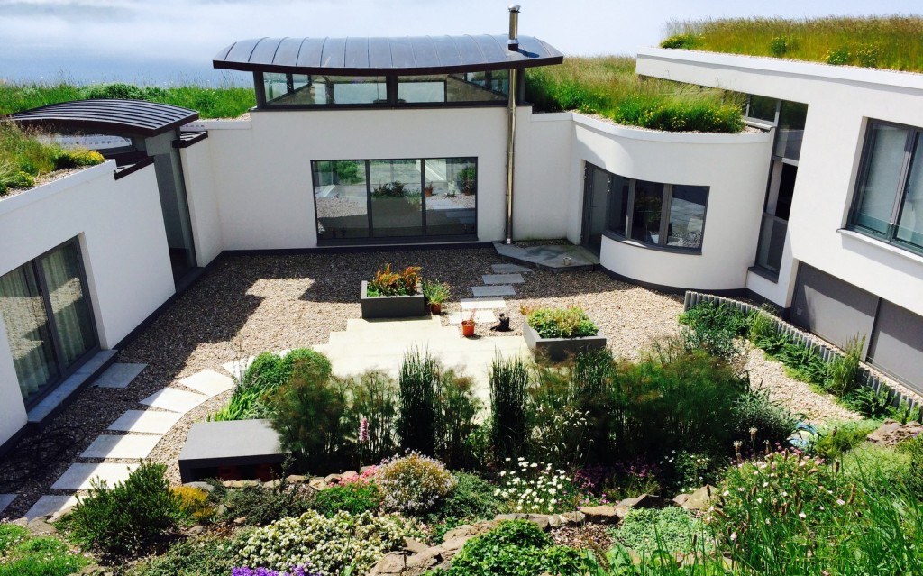 Courtyard of earth-sheltered ICF self-build