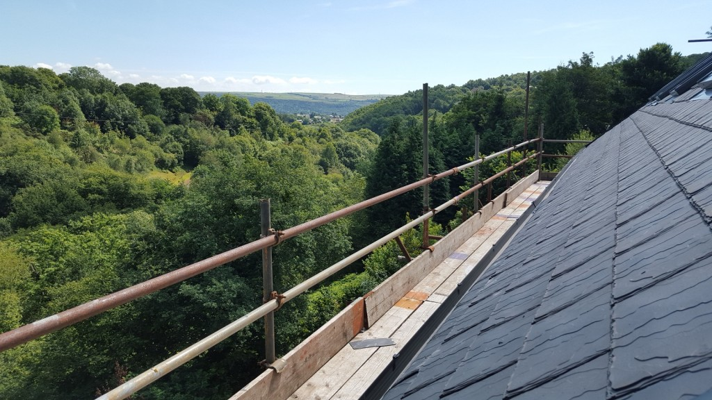 View across Wales from scaffolding, with eco-slate roof tiles