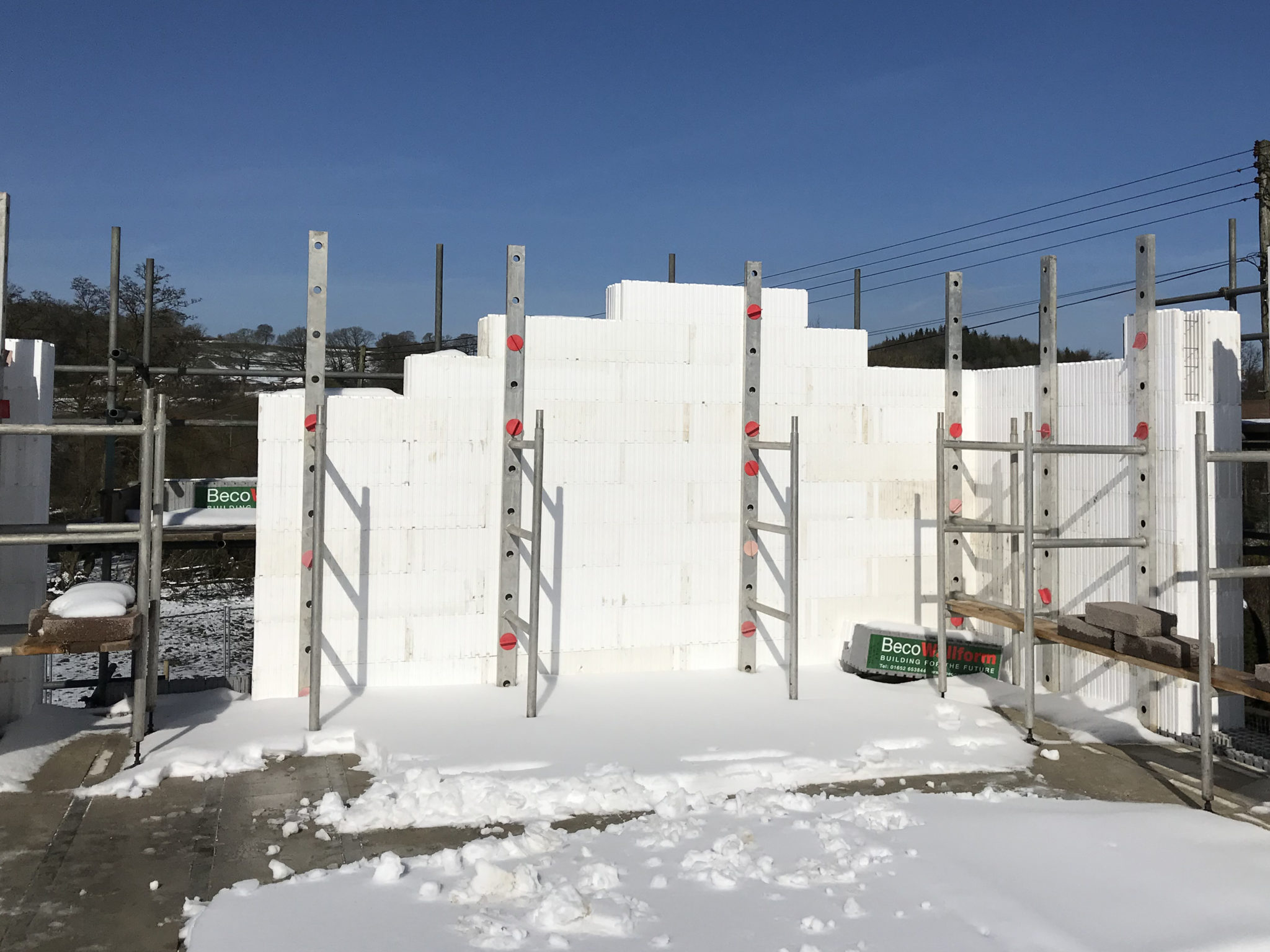 Wallform construction being supported with Beco Alignment system during winter build