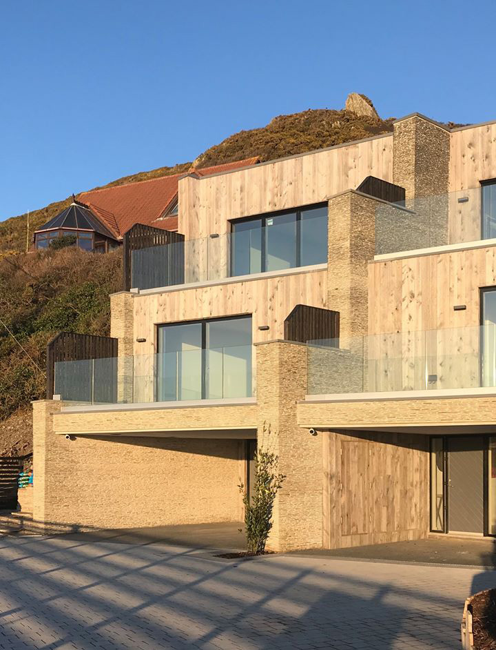 Front elevation of luxury ICF homes, clad with local stone and timber