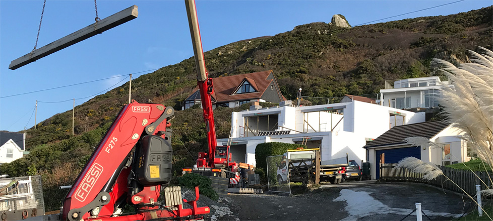 The exposed Wallform ICF structure being loaded with floor beams