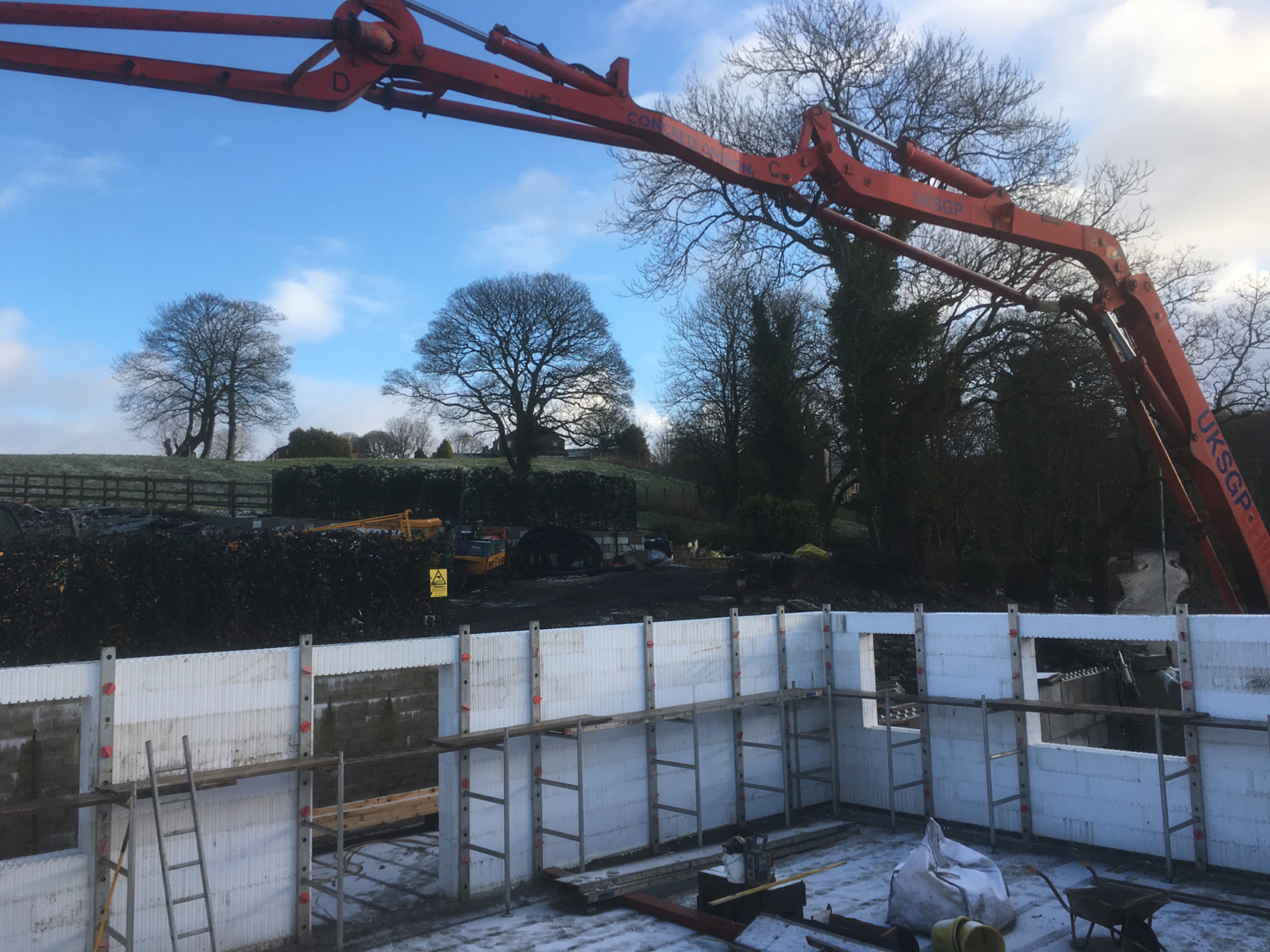 Concrete pump filling Wallform ICF during winter