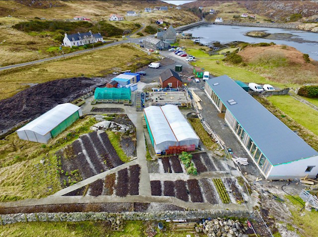 The community building is now practically weathertight - aerial view of the building taken by drone