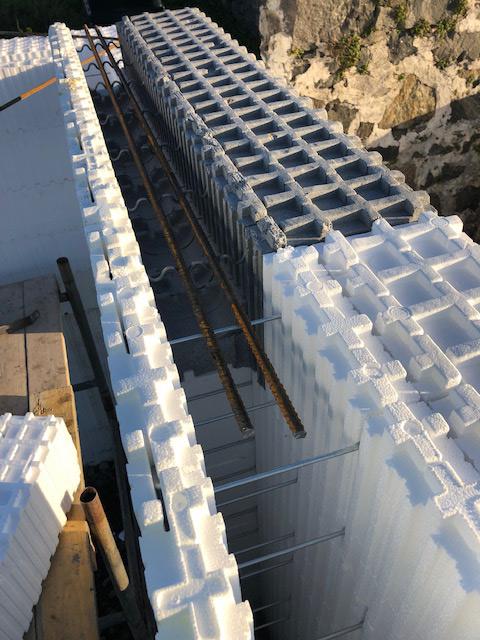 Steel reinforcement, or rebar, is placed inside a Wallform lintel wallblock